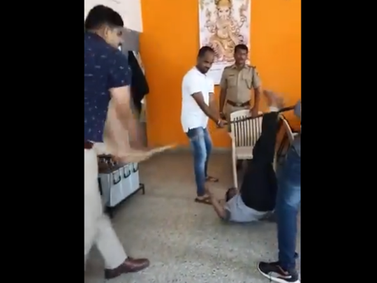 police personnel beating up accused