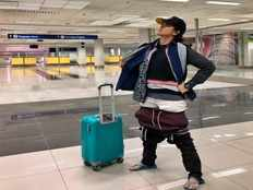 woman wear 2 5 kg clothes to escape from baggage fine photos goes viral