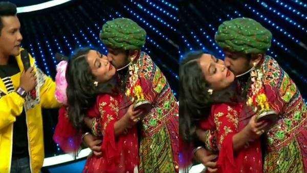 fan forcibly kisses singer neha kakkar on sets of indian idol 11