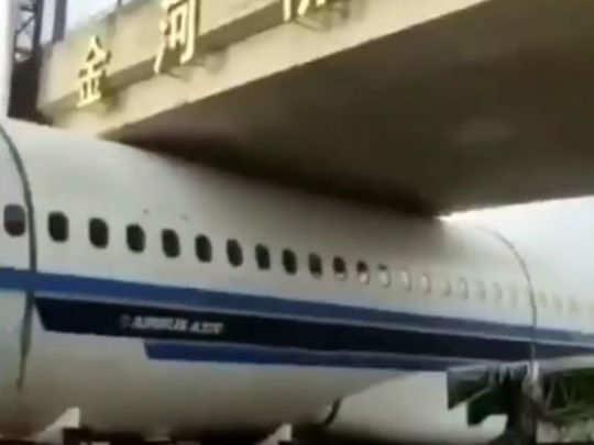 flight stuck under bridge