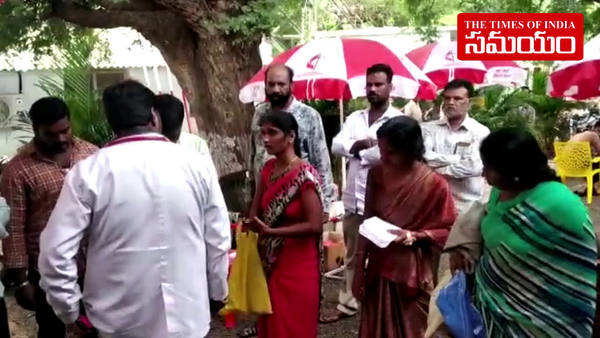 patients getting treatment under umbrellas in vikarabad hospital