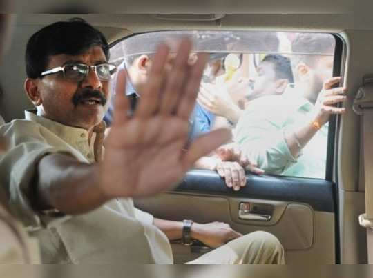 Mumbai: Shiv Sena leader Sanjay Raut gestures as he leaves after getting dischar...