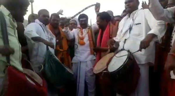 watch trs mla rajaiah turns swordsman in warangal temple