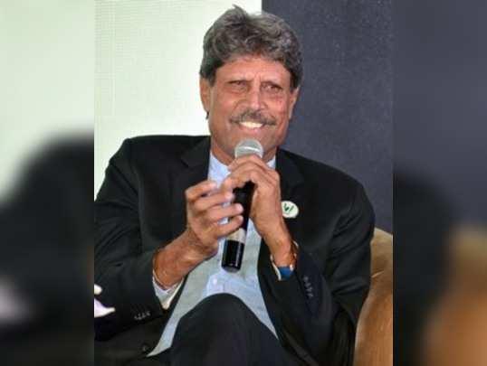 Mumbai: Veteran cricketer Kapil Dev addresses during launch of an application V...