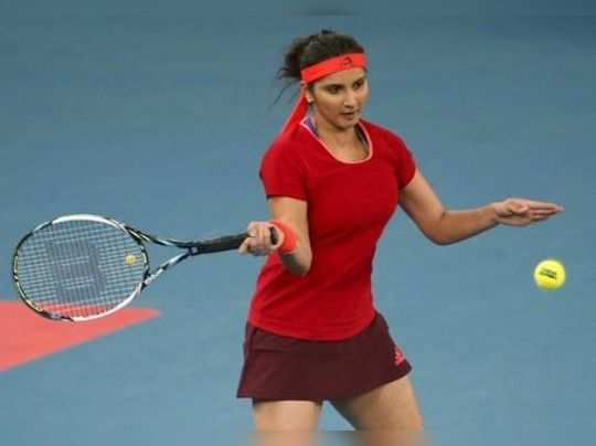 Indian Aces Mirza hits a return to Japan Warriors Lucic-Baroni of Croatia and Herbert of France during their mixed doubles match in the IPTL in New Delhi