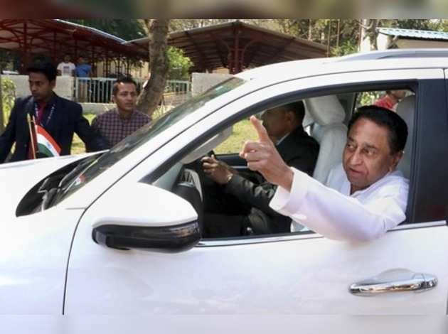 Madhya Pradesh Chief Minister Kamal Nath leaves after a meeting with party MLAs and others, in Bhopal.Photo)(