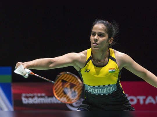 **YEARENDER 2019: SPORTS** Basel: Indias Saina Nehwal returns a shuttlecock to ...