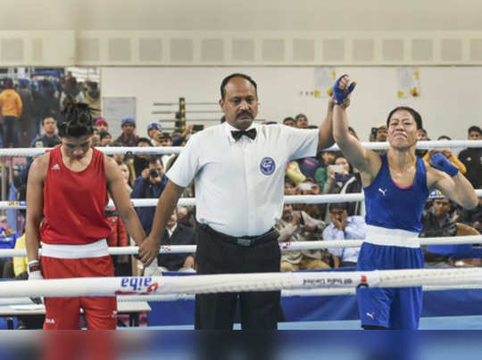 New Delhi: Referee raises the hand of boxer Mary Kom after her bout against Nikh...