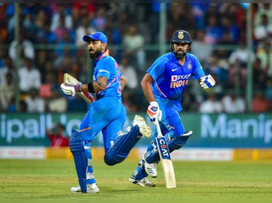 Bengaluru: Indias Rohit Sharma and Virat Kohli run between the wickets during ...