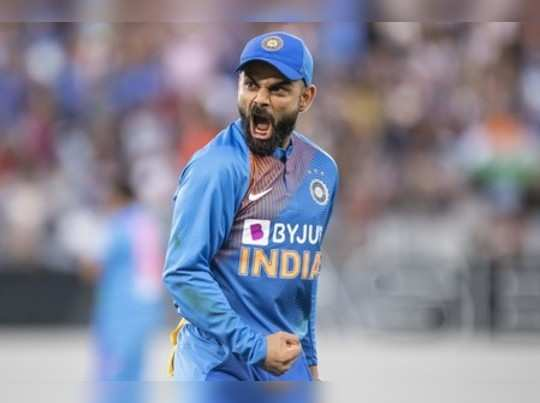 Auckland: Indian captain Virat Kohli reacts to taking the catch to dismiss Marti...