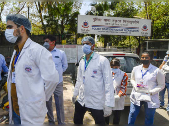 New Delhi: A team of doctors come out of Nizamuddin police station after conduct...