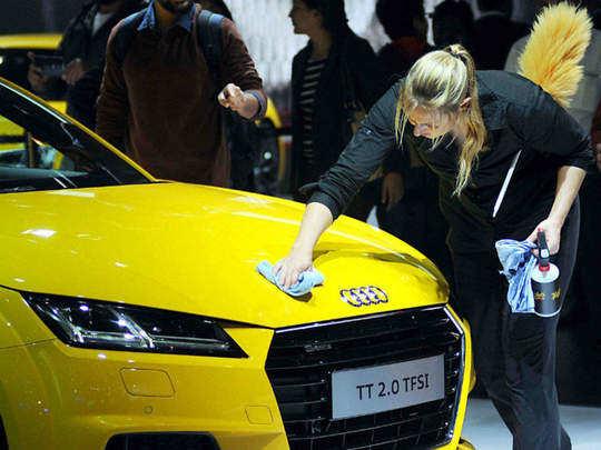 A girl cleaning an Audi TT