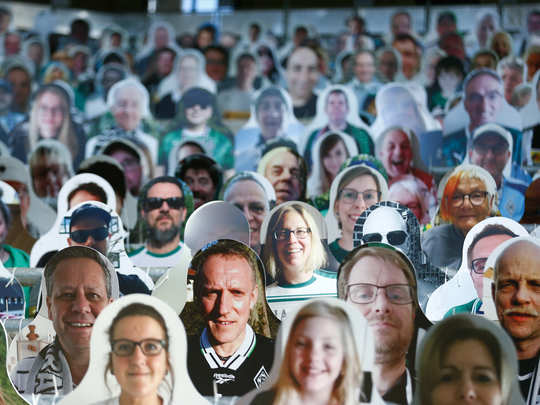 photos of football fans are positioned on the stands of the borussia moenchengladbach soccer stadium