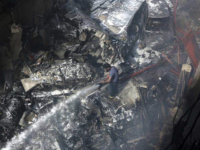 photos and ground report of karachi pia plane crash site