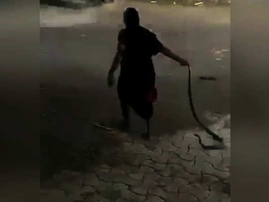old lady with snake viral video