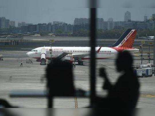 Mumbai: A passenger waits in the lounge area of Chatrapati Shivaji Maharaj Inter...