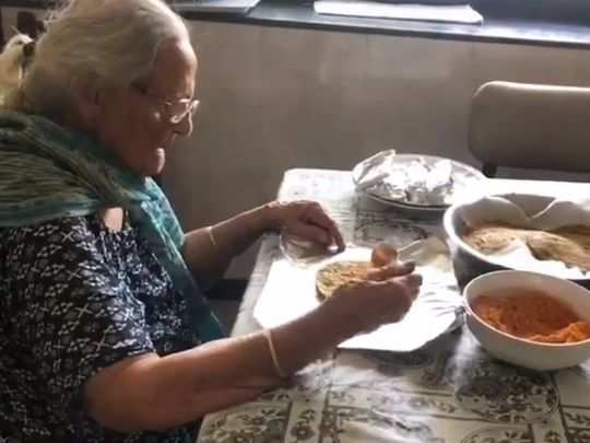 99 year old woman Preparing Food Packets