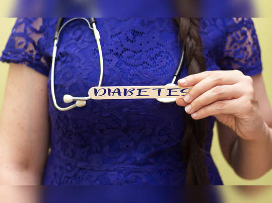 Woman holding wooden spatula with diabetes