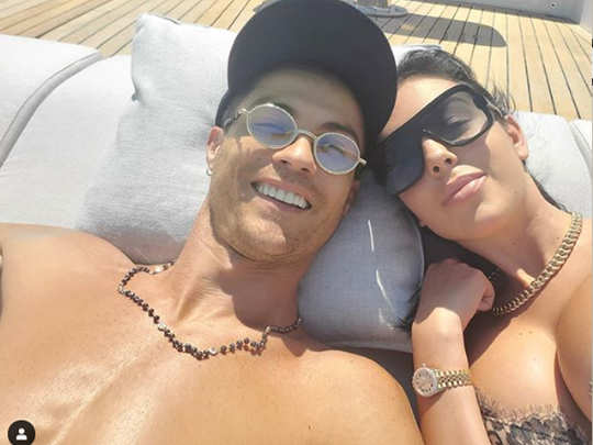 ristiano ronaldo and georgina rodriguez share loved-up selfie as they sunbathe on luxury yacht