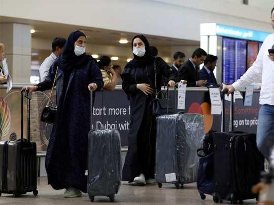 UAE Coronavirus Guidelines: यूएई जाना चाहते हैं? नई गाइडलाइन का पालन करने पर ही मिलेगी एंट्री - uae release coronavirus travel guidelines for all returning residents | Navbharat Times
