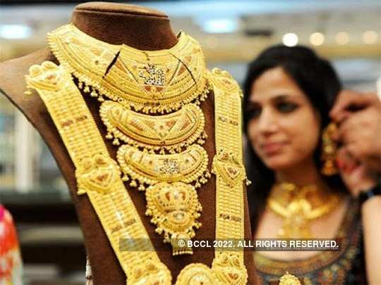 Gold steadies near 8-year high as Covid 19 cases surge, price rises to Rs 48,290 per 10 gram on Tuesday