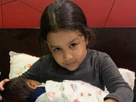 sakshi singh dhoni shared picture of daughter ziva with a child questions on social media