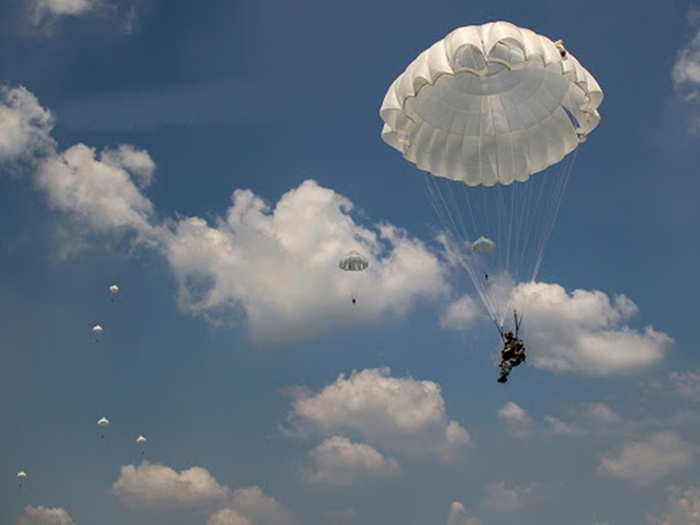 chinese army armed parachute drills by elite pla forces in tibet amid border tension with india