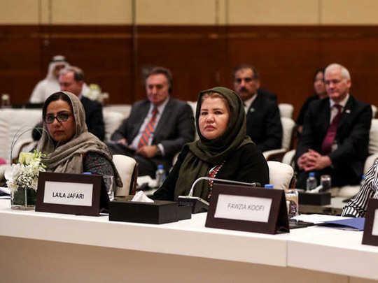 woman in doha peace talk