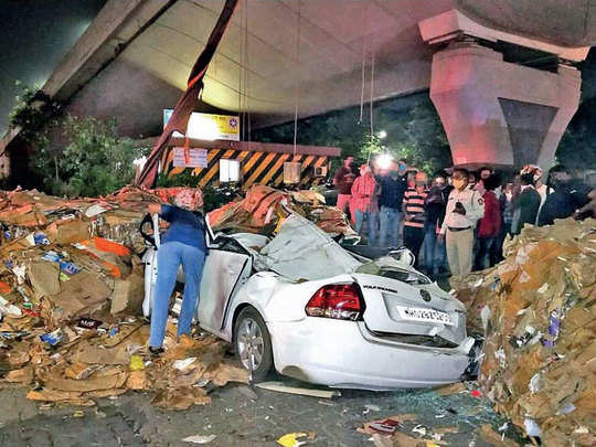 scrap falls on car from truck flyover 20 feet above kills 1 in thane waghbil flyover