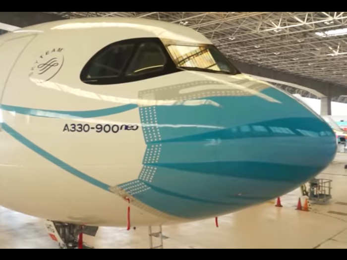 Aeroplane with face mask livery
