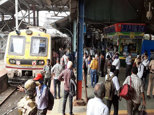 mumbai power outage, local trains stopped, people seen on railway track