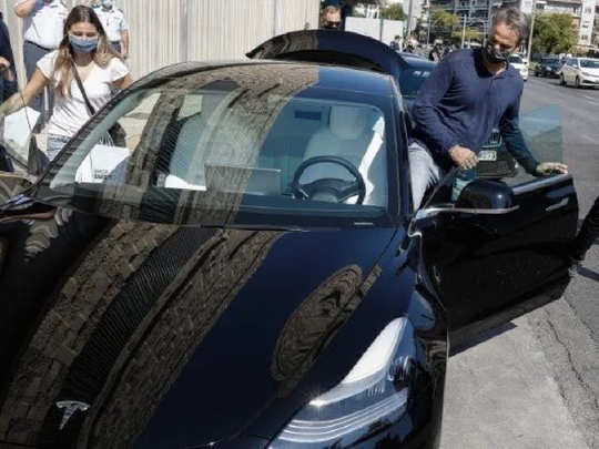 Kyriakos Mitsotakis with Tesla Model 3