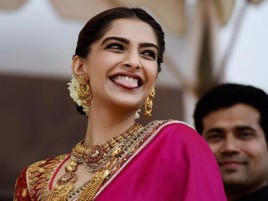 sonam kapoor trolled in celia kritharoiti green and pink dress