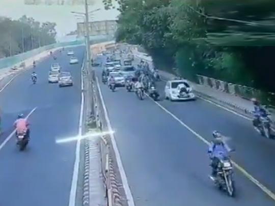Delhi traffic cop dragged on car bonnet