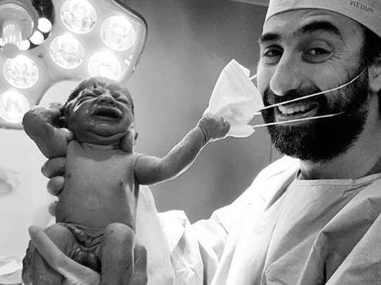 new born baby remove doctors mask