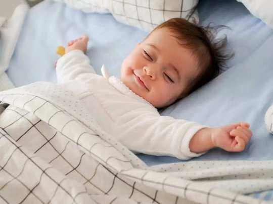 why babies smile while sleeping in marathi