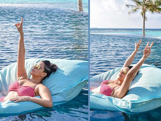 neha dhupia chilling in maldives she looks stunning while sunbathing on a pool pillow