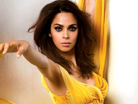 mallika sherawat in yellow polka dress for her birthday celebration