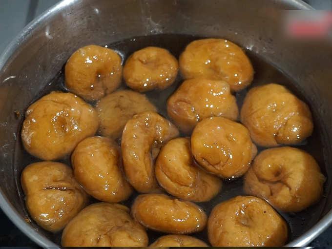 dip badusha in sugar syrup