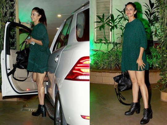 rakul preet singh flaunts her toned legs in green short dress and high heel boots