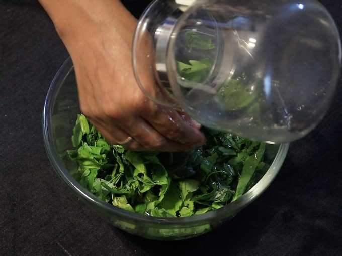 add water and greens in a pan