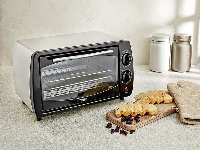 Pigeon by Stovekraft Electric Oven Toaster and Griller, 16-Litre with barbeque rack, crumb tray, pan handle and skewer rods