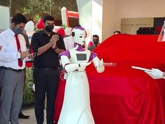Robot takes delivery of new car.