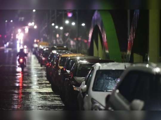 Chennai: Residents park their vehicles on a flyover before the landfall of Cyclo...