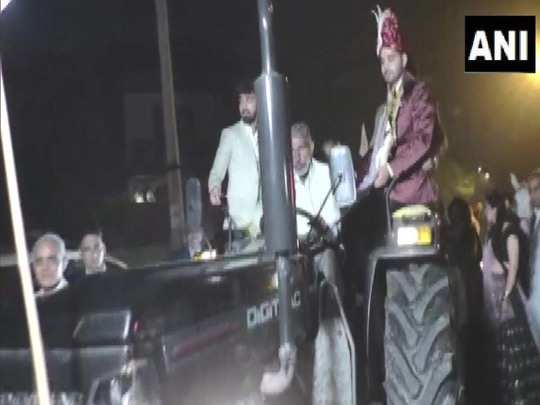 groom rides a tractor to his wedding venue to show support to farmers protest in karnal