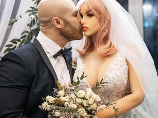 bodybuilder yuri tolochko married his beloved sex doll in kazakhstan