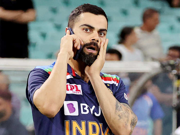 virat kohli talking on phone after t20 series win in australia see pictures