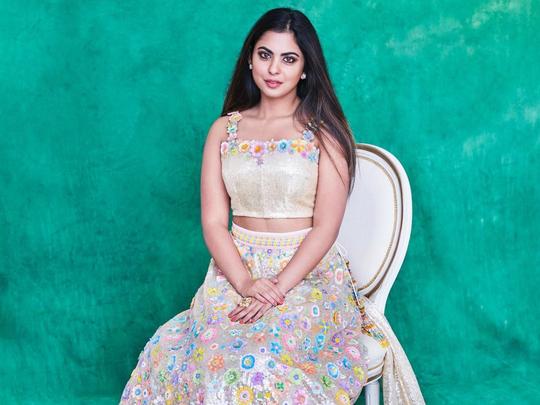 from pink lehenga to sequence sari isha ambani always a stylish wedding guest