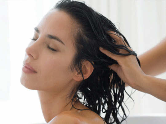 apply coconut water to your hair scalp to get thick soft and shiny hair