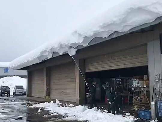 Japanese man snow off his roof